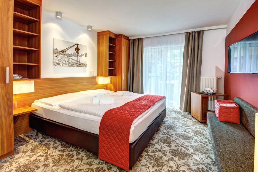 AlpenParks Hotel & Apartment Maria Alm - Slide 2