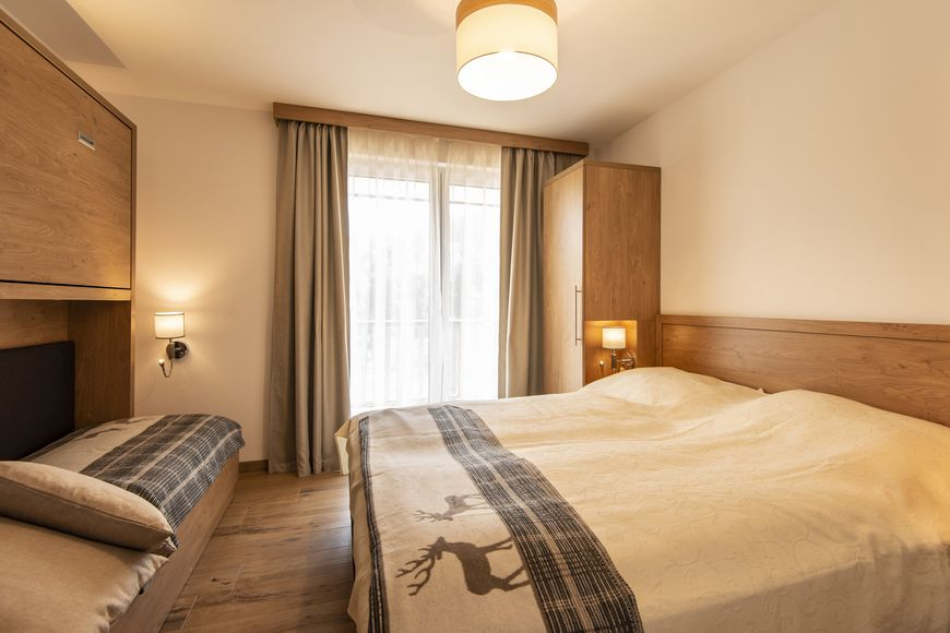 Slide4 - ADAPURA Chalet & Apartment Resort
